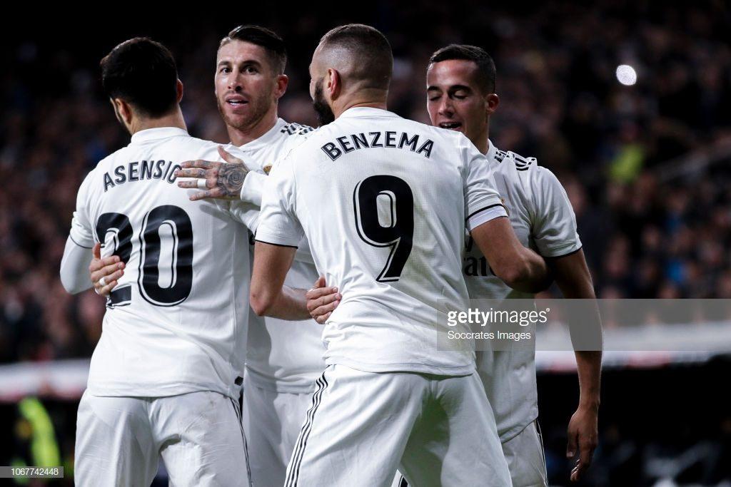 Marco Asensio, Sergio Ramos and Karim Benzema of Real Madrid